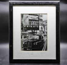 A Fergus Noonesigned and dated print of a london black taxi