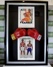 A signed Muhammad Ali & Joe Frazier gloves & original