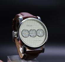 A gent's Otium Trigulatuer watch, new boxed ex display example RRP £2499