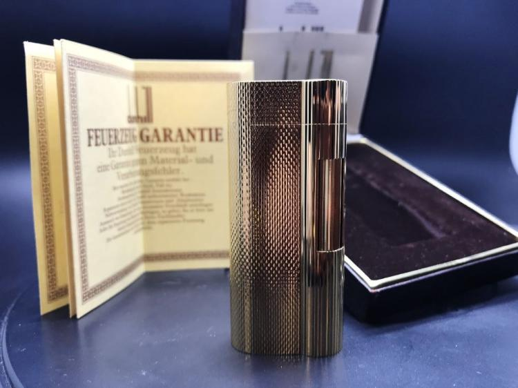 Gold plated Dunhill lighter in excellent order/case & papers