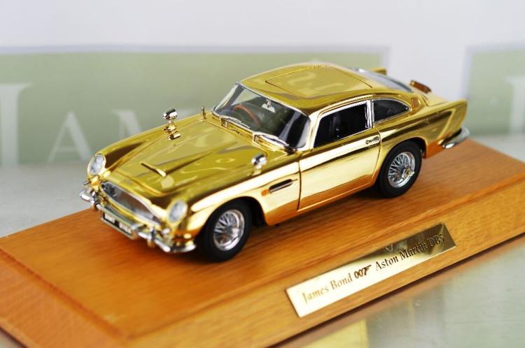 Danbury Mint - Special edition 22 carat gold plated James Bond Aston Martin DB5, with original display plinth