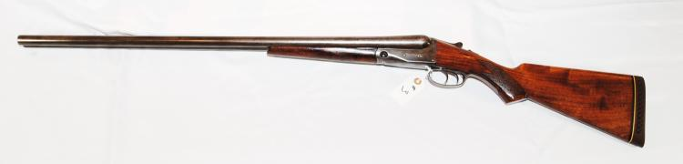 PARKER BROS. 12 GA. SIDE-BY-SIDE DOUBLE  BARREL MODEL TROJAN SHOTGUN - SERIAL # 218586  - IT HAS A 30-INCH BARREL AND THE OVERALL  CONDITION IS GOOD. PRE AUCTION ESTIMATE -  $1,000 - $2,000