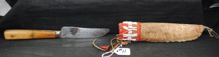 RARE LATE 19TH CENTURY EASTERN LAKOTA PATCH  KNIFE AND AND ORIGINAL MULEDEER SCABBARD -  SHEATH OF MONTANA MULE DEER BRAIN TANED HIDE  WITH ELK RAWHIDE LINER. WOOL NECK, ELK SINEW  SEWN TIN CONES, VENETIAN GLASS BEADS - 1850-1880 WITH RARE EARLIER COLOR SOWN ON  EDGE. THE KNIFE IS MARKED W. WEBSTER -  SHEFFIED. THE GRIPS ARE MADE OF BONE. - PRE  AUCTION ESTIMATE $1,750 - $2,500