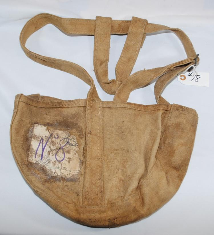 THE CANVAS PAYROLL BAG BEARING A PAPER LABEL WITH OFFICIAL BOLIVIAN ARMY SEALS DATED 7 NOVIEMBRE DE 1908 IS ONE OF THE TWO