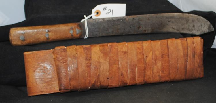 RARE INDIAN KNIFE WITH ORIGINAL TREE BARK  SCABBARD - APPROX. OVERALL LENGTH 17 1/4  INCHES AND BLADE APRPOX. 12 INCHES - PRE  AUCTION ESTIMATE $1,500 - $1,850