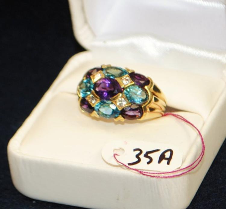 LADIES 18K 750 (STAMPED) YELLOW GOLD DIAMOND AND COLORED STONE FASHION RING. THE RING IS CHANNEL SET WITH (4) 2.5MM ROUND FULL CUT DIAMONDS FOR A TOTAL CARAT WEIGHT OF .25CT. ALL DIAMONDS HAVE A MINIMUM COLOR GRADE OF I AND CLARITY GRADE OF SI2. THE RING IS ALSO SET WITH (4) 7X5MM OVAL SHAPE BLUE TOPAZ, (4) 6X4MM OVAL SHAPE AMETHYST, (1) 8X6MM OVAL SHAPE AMETHSYT FOR A TOTAL CARAT WEIGHT OF 7.50CTTW. ALL COLORED GEMSTONES ARE DOUBLE AA QUALITY. ALL GEMSTONES WERE GRADED WHILE SET IN THE MOUNTING AND CARAT WEIGHTS CALCULATED BY FORMULA. TOTAL METAL WEIGHT WITH GEMSTONES: 12.8 GRAMS.THE TOTAL RETAIL REPLACEMENT VALUE: $3,200.00. AND COMES WITH THE APPRAISAL FOR INSURANCE PURPOSES.