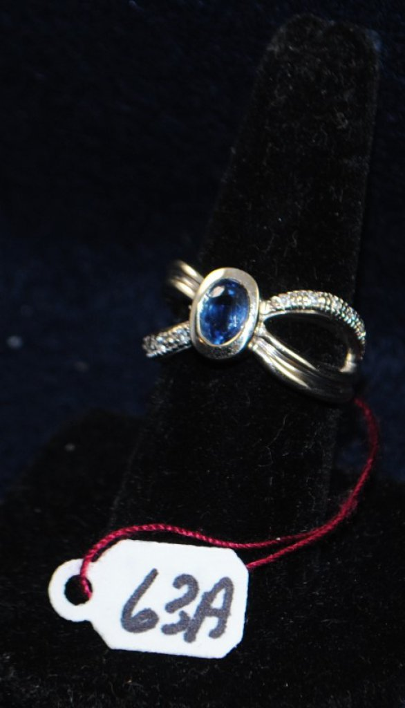 LADIES 14K (STAMPED) WHITE GOLD DIAMOND AND BLUE SAPPHIRE RING. THE RING IS PRONG SET WITH (12) 1.4-1.5MM ROUND FULL CUT DIAMONDS FOR A TOTAL CARAT WEIGHT OF .15CTTW. ALL DIAMONDS HAVE A MINIMUM COLOR GRADE OF I AND CLARITY GRADE OF I1. THE RING IS ALSO BEZEL SET WITH (1) 7X5MM OVAL SHAPE BLUE SAPPHIRE FOR A TOTAL CARAT WEIGHT OF 1.00CTTW. THE BLUE SAPPHIRE IS SINGLE A QUALITY. ALL GEMSTONES WERE GRADES WHILE SET IN THE MOUNTING AND CARAT WEIGHTS WERE CALCULATED BY FORMULA. TOTAL METAL WEIGHT: 8.5 GRAMS. THE TOTAL RETAIL REPLACEMENT VALUE: $2,100.00. AND COMES WITH THE APPRAISAL FOR INSURANCE PURPOSES.