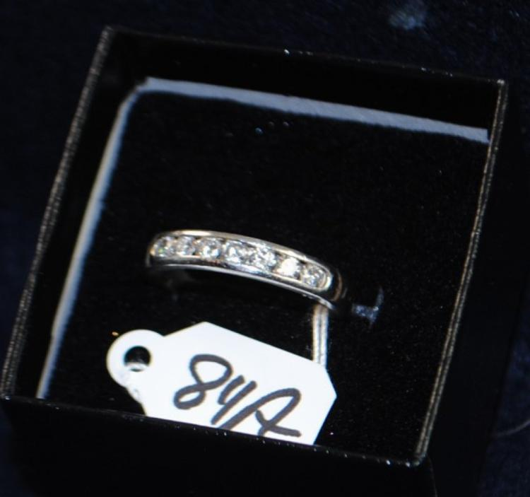 LADIES PLAT (STAMPED) PLATINUM DIAMOND WEDDING BAND. THE RING IS PRONG SET WITH (7) 2.3-2.4MM ROUND FULL CUT DIAMONDS FOR A TOTAL CARAT WEIGHT OF .33CT. ALL DIAMONDS HAVE A MINIMUM COLOR GRADE OF I AND CLARITY GRADE OF SI2. ALL GEMSTONES WERE GRADED WHILE SET IN THE MOUNTING AND CARAT WEIGHTS WERE CALCULATED BY FORMULA. TOTAL METAL WEIGHT WITH GEMSTONES: 5.5 GRAMS. THE TOTAL RETAIL REPLACEMENT VALUE: $2,000.00. AND COMES WITH THE APPRAISAL FOR INSURANCE PURPOSES.