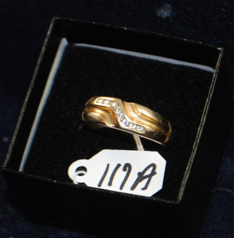 MEN'S 14K (STAMPED) YELLOW GOLD RING. THE RING IS CHANNEL SET WITH (8) 1.7-1.8MM ROUND FULL CUT DIAMONDS FOR A TOTAL CARAT WEIGHT OF .25CT. ALL DIAMONDS HAVE A MINIMUM COLOR GRADE OF I AND CLARITY GRADE OF I1. ALL GEMSTONES WERE GRADED WHILE SET IN THE MOUNTING AND CARAT WEIGHTS CALCULATED BY FORMULA. TOTAL METAL WEIGHT WITH GEMSTONES: 4.5 GRAMS. THE TOTAL RETAIL REPLACEMENT VALUE: 1,300.00. AND COMES WITH THE APPRAISAL FOR INSURANCE PURPOSES