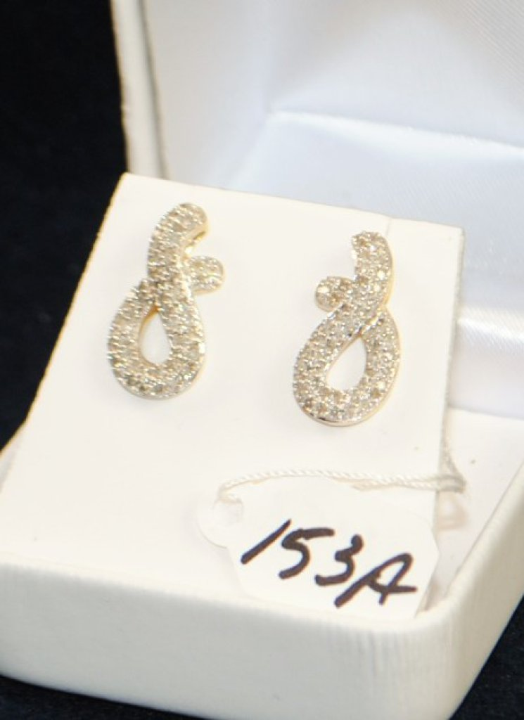 PAIR OF LADIES 10K (STAMPED) YELLOW GOLD DIAMOND EARRINGS. THERE ARE A TOTAL OF (46) 1.0-1.1MM ROUND SINGLE CUT DIAMONDS PRONG SET IN THE EARRINGS FOR A TOTAL CARAT WEIGHT OF .25CTTW. ALL DIAMONDS HAVE A MINIMUM COLOR GRADE OF I AND CLARITY GRADE OF I1. ALL GEMSTONES WERE GRADED WHILE SET IN THE MOUNTING AND CARAT WEIGHTS WERE CALCULATED BY FORMULA. TOTAL METAL WEIGHT WITH GEMSTONES: 3.2 GRAMS. THE TOTAL RETAIL REPLACEMENT VALUE: $1,000.00. AND COMES WITH THE APPRAISAL FOR INSURANCE PURPOSES.