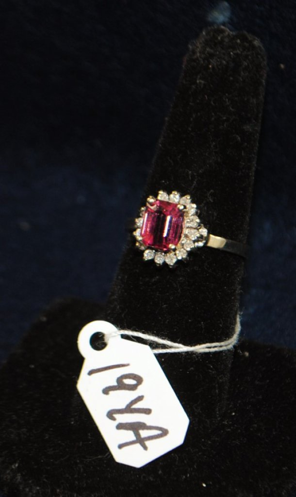 LADIES 14K (STAMPED) YELLOW AND WHITE GOLD DIAMOND AND PINK TOURMALINE RING. THE RING IS PRONG SET WITH (16) 1.5MM ROUND SINGLE CUT DIAMONDS FOR A TOTAL CARAT WEIGHT OF .25CT. ALL DIAMONDS HAVE A MINIMUM COLOR GRADE OF I AND CLARITY GRADE OF I1. THE CENTER OF THE RING IS PRONG SET WITH (1) 7X6X4MM EMERALD CUT PINK TOURMALINE FOR AN APPROX. CARAT WEIGHT OF 1.50CT. THE PINK TOURMALINE IS DOUBLE AA QUALITY. ALL GEMSTONES WERE GRADE WHILE SET IN THE MOUNTING AND CARAT WEIGHTS CALCULATED BY FORMULA. TOTAL METAL WEIGHT WITH GEMSTONES: 2.9 GRAMS. THE TOTAL RETAIL REPLACEMENT VALUE: $1,750.00. AND COMES WITH THE APPRAISAL FOR INSURANCE PURPOSES.