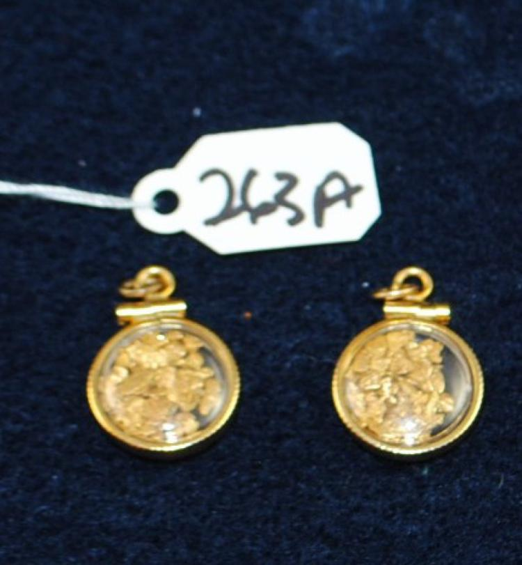 TWO 18K (STAMPED) YELLOW GOLD PENDANTS. EACH PENDANT IS CIRCULAR AND IS FILLED WITH SMALL GOLD NUGGETS. TOTAL METAL WEIGTH: 1.7 GRAMS. THE TOTAL RETAIL REPLACEMENT VALUE: $600.00. AND COMES WITH THE APPRAISAL FOR INSURANCE PURPOSES.