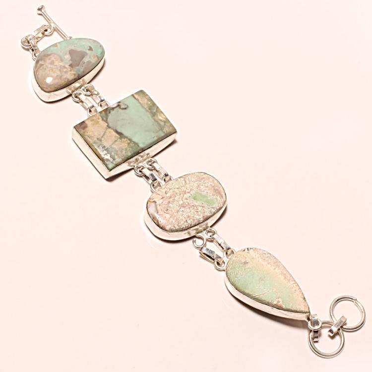 STAMPED .925 STERLING SILVER BRACELET WITH UNIDENTIFIED STONES