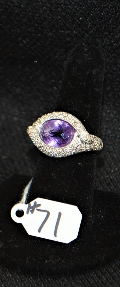 LADIES 18K 750 (STAMPED) WHITE GOLD DIAMOND AND AMETHYST FASHION RING. THE RING IS PAVE SET WITH (84) 1.1-1.3MM ROUND FULL CUT DIAMONDS FOR A TOTAL CARAT WEIGHT OF .50CTTW. ALL ROUND FULL CUT DIAMONDS HAVE A MINIMUM COLOR GRADE OF I  AND CLARITY GRADE OF I1. THE CENTER OF THE RING IS BEZEL SET WITH (1) 12X10 MM OVAL SHAPE AMETHSYT WEIGHING APPROX. 5.00CT. THE AMETHYST IS SINGLE A QUALITY. ALL  GEMSTONES WERE GRADED WHILE SET IN THE MOUNTING AND CARAT WEIGHTS CALCULATED BY FORMULA. TOTAL METAL WEIGHT WITH GEMSTONES: 12.3 GRAMS. THE TOTAL RETAIL REPLACEMENT VALUE: $3,000.00. AND COMES WITH THE APPRAISAL FOR INSURANCE PURPOSES.