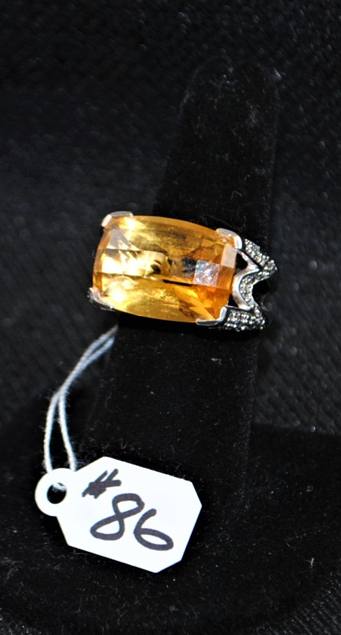 LADIES 18K (STAMPED) WHITE GOLD CITRINE AND DIAMOND RING. THE RING IS PRONG SET WITH (50) 1.2-1.3MM ROUND FULL CUT DIAMONDS FOR A TOTAL CARAT WEIGHT OF .50CTTW. ALL ROUND FULL CUT DIAMONDS HAVE A MINIMUM COLOR  GRADE OF I AND CLARITY GRADE OF I1. THE CENTER OF THE RING IS PRONG SET WITH (1) AA QUALITY 18X13MM RECTANGULAR SHAPE CITRINE WEIGHING APPROX. 14.25CT. ALL GEMSTONES WERE GRADED WHILE SET IN THE MOUNTING AND CARAT WEIGHTS WERE CALCULATED BY FORMULA. THE TOTAL METAL WEIGHT WITH GEMSTONES: 13.8 GRAMS. THE TOTAL RETAIL REPLACEMENT VALUE: $3,100.00. AND COMES WITH THE APPRAISAL FOR INSURANCE PURPOSES.
