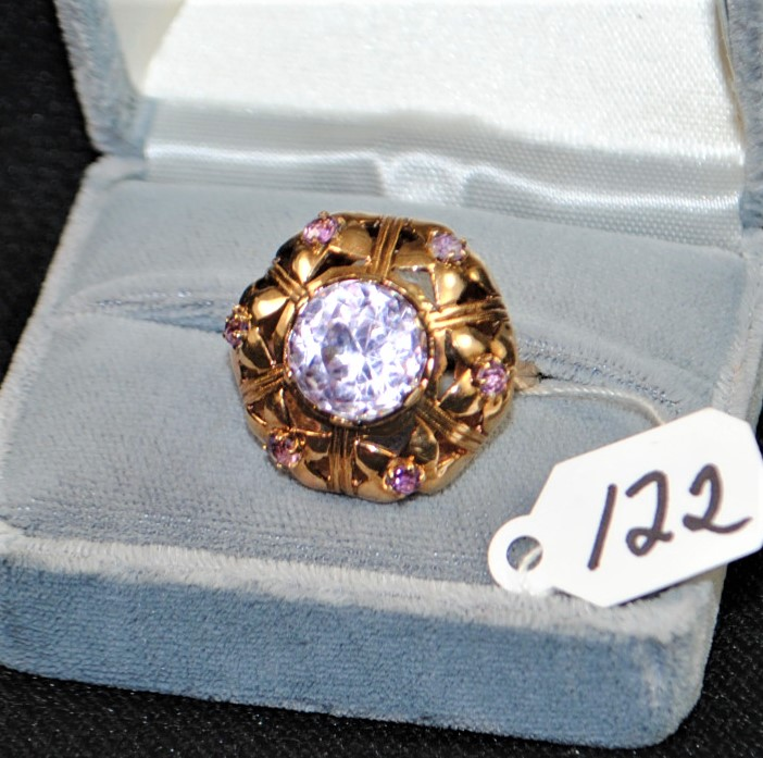 LADIES 14K (STAMPED) YELLOW GOLD AMETHYST FASHION RING. THE RING IS PRONG SET WITH (6) 2.5MM ROUND SHAPE AMETHYST AND (1) 10.7MM ROUND SHAPE AMETHYST FOR A TOTAL CARAT WEIGHT OF 5.00CTTW. ALL AMETHYST HAVE A MINIMUM QUALITY OF A QUALITYY. ALL GEMSTONES WERE GRADED WHILE SET IN THE MOUNTING AND CARAT WEIGHTS WERE CALCULATED BY FORMULA. THE TOTAL METAL WEIGHT WITH GEMSTONES: 10.6 GRAMS. THE TOTAL RETAIL REPLACEMENT VALUE: 1,500.00. AND COMES WITH THE APPRAISAL FOR INSURANE PURPOSES.