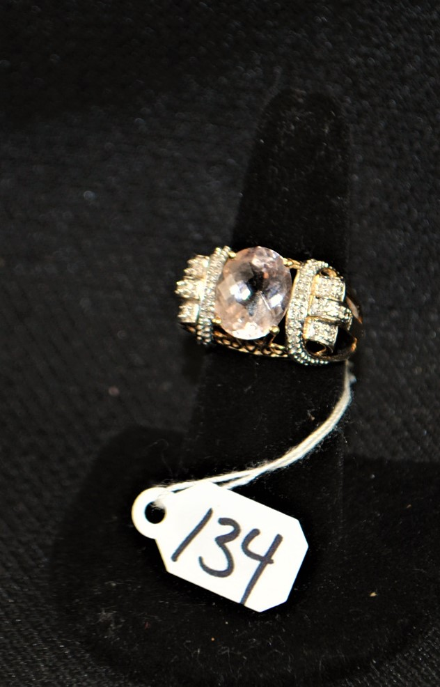 LADIES 14K (STAMPED) YELLOW GOLD KUNZITE FASHION RING. THE RING IS PRONG SET WITH (1) 12X10MM OVAL SHAPE KUNZITE WEIGHING APPROX. 5.00CT. THE KUNZITE IS SINGLE A QUALITY. ALL GEMSTONES WERE GRADED WHILE SET IN THE MOUNTING AND CARAT WEIGHTS WERE CALCULATED BY FORMULA. NOTE: DIAMONDS WERE NOT GRADED AS SO MANY ARE MISSING. TOTAL WEIGHT OF WITH GEMSTONES: 6.6 GRAMS. TOTAL RETAIL REPLACEMENT VALUE: $1,500.00.  AND COMES WITH THE APPRAISAL FOR INSURANCE PURPOSES.