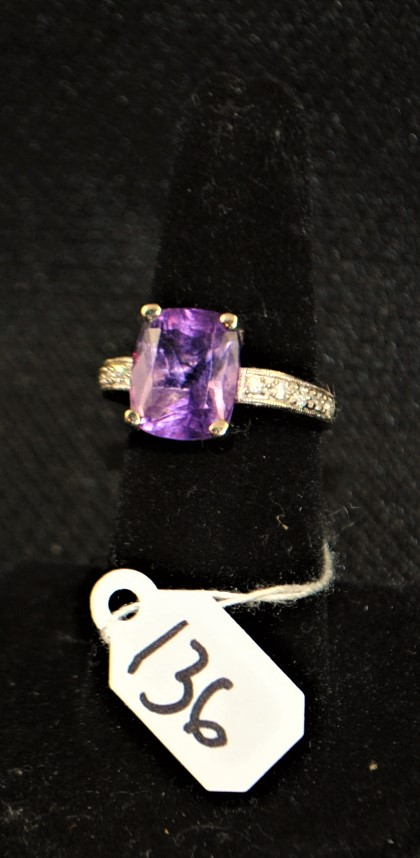 LADIES 14K (STAMPED) WHITE GOLD DIAMOND AND AMETHYST FASHION RING. THE RING IS PRONG SET WITH (10) 1.3 -1.4MM ROUND FULL CUT DIAMONDS FOR A TOTAL CARAT WEIGHT OF .10CTTW. ALL DIAMONDS HAVE A MINIMUM COLOR GRADE OF I AND CLARITY GRADE OF I1. THE CENTER OF THE RING IS PRONG SET WITH (1) 12 X 10MM RECTANGULAR CUSHION SHAPE AMETHYST WEIGHING APPROX. 5.00CT. THE AMETHYST IS A SINGLE A QUALITY. ALL GEMSTONES WERE GRADED WHILE SET IN THE MOUNTING AND CARAT WEIGHTS WERE CALCULATED BY FORMULA. THE TOTAL METAL WEIGHT WITH GEMSTONES: 5.0 GRAMS. THE TOTAL RETAIL REPLACEMENT VALUE: $1,350.00. AND COMES WITH THE APPRAISAL  FOR INSURANCE PURPOSES