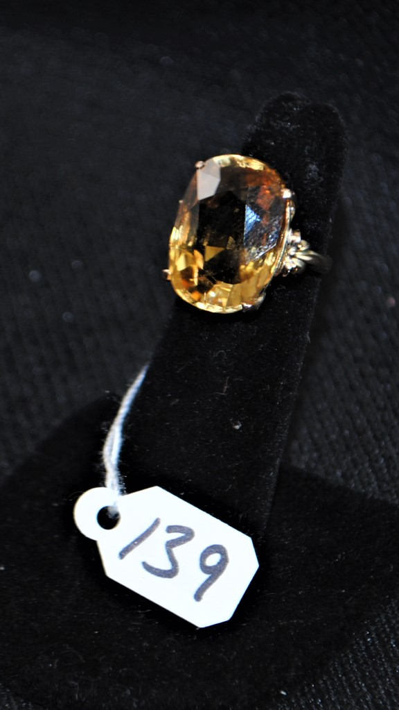 LADIES 14K (STAMPED) YELLOW GOLD CITRINE FASHION RING. THE CENTER OF THE RING IS PRONG SET WITH (1) 19.1 X 13.5 MM CITRINE WEIGHING APPROX. 17.0CT. THE CITRINE IS A SINGLE A QUALITY. ALL GEMSTONES WERE GRADED WHILE SET IN THE MOUNTING AND CARAT WEIGHTS CALCULATED BY FORMULA. THE TOTAL METAL WEIGHT WITH GEMSTONES: 6.0 GRAMS. THE TOTAL RETAIL REPLACEMENT VALUE: $1,150.00. AND COMES WITH THE APPRAISAL FOR INSURANCE PURPOSES.