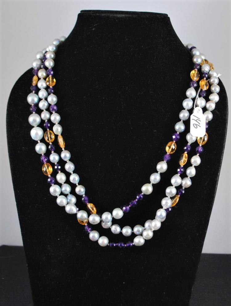 STRAND OF 7.0 0 - 10.0 MM NEAR ROUND DYED CULTURED PEARLS. THE STRAND OF PEARLS HAS CITRINE AND AMETHYST BEADS. THE STRAND IS KNOTTED, 63 INCHES IN LENGTH AND COMES WITH A YELLOW GOLD PLATED CLASP. TOTAL RETAIL REPLACEMENT VALUE: $1,000.00. AND COMES WITH THE APPRAISAL FOR INSURANCE PURPOSES.