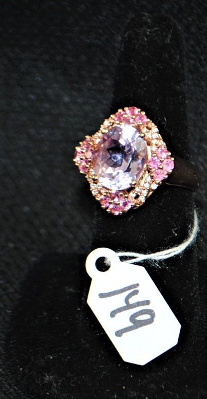 LADIES 14K (STAMPED) YELLOW GOLD KUNZITE FASHION RING. THE RING IS PRONG SET WITH (16) 2.1-2.2MM ROUND SHAPE PINK TOURMALINES AND (28) 1.0-1.1MM ROUND SHAPE FULL CUT DIAMONDS FOR A TOTAL CARAT WEIGHT OF .65CTTW. ALL PINK TOURMALINES HAVE A MINIMUM QUALITY GRADE OF A QUALITY. ALL ROUND FULL CUT DIAMONDS HAVE A MINIMUM COLOR GRADE OF J AND CLARITY GRADE OF I1. THE CENTER OF THE RING IS PRONG SET WITH (1) 12X10MM OVAL SHAPE KUNZITE FOR A TOTAL CARAT WEIGHT OF 5.00CTTW. KUNZITE HAS A DOUBLE AA QUALITY GRADE. ALL GEMSTONES WERE GRADED WHILE SET IN THE MOUNTING AND CARAT WEIGHTS WERE CALCULATED BY FORMULA. THE TOTAL METAL WEIGHT WITH GEMSTONES: 10.1 GRAMS.THE TOTAL RETAIL REPLACEMENT VALUE: $1,300.00. AND COMES WITH THE APPRAISAL FOR INSURANCE PURPOSES.