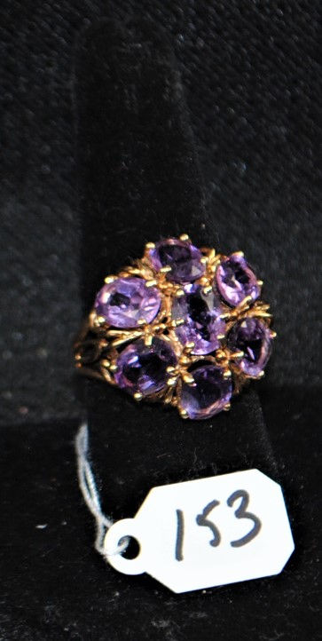 LADIES 14K (TESTED) YELLOW GOLD AMETHYST FASHION RING. THE RING IS PRONG SET WITH (7) 8X6MM OVAL SHAPE AMETHYST FOR A TOTAL CARAT WEIGHT OF 10.50CTTW. ALL AMETHYST HAVE A MINIMUM QUALITY GRADE OF A. ALL GEMSTONES WERE GRADED WHILE SET IN THE MOUNTING AND CARAT WEIGTS WERE CALCULATED BY FORMULA. TOTAL METAL WEIGHT WITH GEMSTONES: 6.5 GRAMS. THE TOTAL RETAIL REPLACEMENT VALUE: $1,250.00. AND COMES WITH THE APPRAISAL FOR INSURANCE PURPOSES.