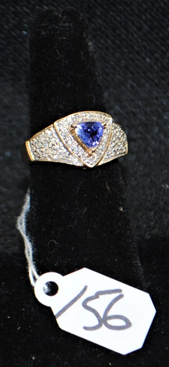 LADIES 14K (STAMPED) YELLOW GOLD DIAMOND AND TANZANITE RING. THE RING IS PRONG SET WITH (45) 1.0-1.1MM ROUND SINGLE CUT DIAMONDS FOR A TOTAL CARAT WEIGHT OF .25CTTW. ALL ROUND FULL CUT DIAMONDS HAVE A MINIMUM COLOR GRADE OF I AND CLARITY GRADE OF I1. THE CENTER OF THE RING IS PRONG SET WITH (1) AA QUALITY 5.5X5.5X5.5MM TRILLION CUT TANZANITE WEIGHING APPROX. .40CT. ALL GEMSTONES WERE GRADED WHILE SET IN THE MOUNTING AND CARAT WEIGHTS WERE CALCULATED BY FORMULA. THE METAL WEIGHT WITH GEMSTONES: 4.5 GRAMS. TOTAL RETAIL REPLACEMENT VALUE: $1,000.00. AND COMES WITH THE APPRAISAL FOR INSURANCE PURPOSE.