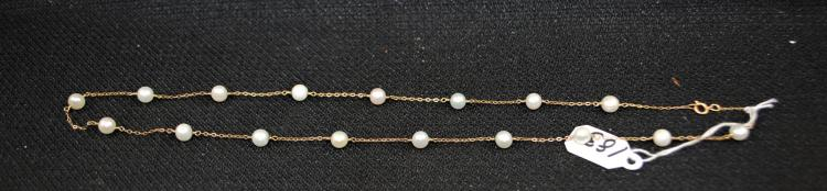ONE 14K (TESTED) YELLOW GOLD AND PEARL NECKLACE. THERE ARE (17) 5MM A QUALITY CULTURED PEARLS. THE NECKLACE IS 17 INCHES IN LENGTH AND COMES EQUIPPED WITH A 14K O-RING STYLE CLASP. TOTAL RETAIL REPLACEMENT VALUE: $550.00. AND COMES WITH THE APPRAISAL FOR INSURANCE PURPOSES.