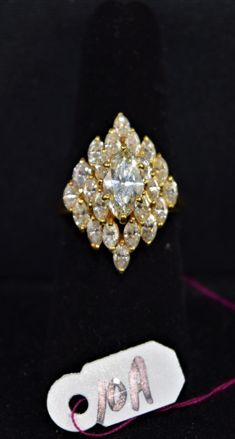 LADIES 18K (STAMPED) YELLOW GOLD DIAMOND CLUSTER FASHION RING. THE RING IS PRONG SET WITH (22) 4.5x2.5MM MARQUISE CUT DIAMONDS FOR A TOTAL CARAT WEIGHT OF 3.08CTTW. ALL MARQUISE DIAMONDS HAVE A MINIMUM COLOR GRADE OF K AND CLARITY GRADE OF VS2. THE CENTER OF THE RING IS SIX PRONG SET WITH (1) MARQUISE CUT DIAMOND. ALL GEMSTONES WERE GRADE WHILE SET IN THE MOUNTING AND CARAT WEIGHTS ARE CALCULATED BY FORMULA. CENTER MARQUISED CUT DIAMOND DETAILS ARE AS FOLLOWS: MEASUREMENTS: 10.75X5.77X3.18MM (APPROX), CARAT WEIGHT: 1.27CT (APPROX), COLOR: K, CLARITY: VS2, CUT GRADE: VERY GOOD. TOTAL METAL WEIGHT WITH GEMSTONES; 7.64 GRAMS. TOTAL RETAIL REPLACEMENT VALUE: $13,000.00. AND COMES WITH THE APPRAISAL FOR INSURANCE PURPOSES.