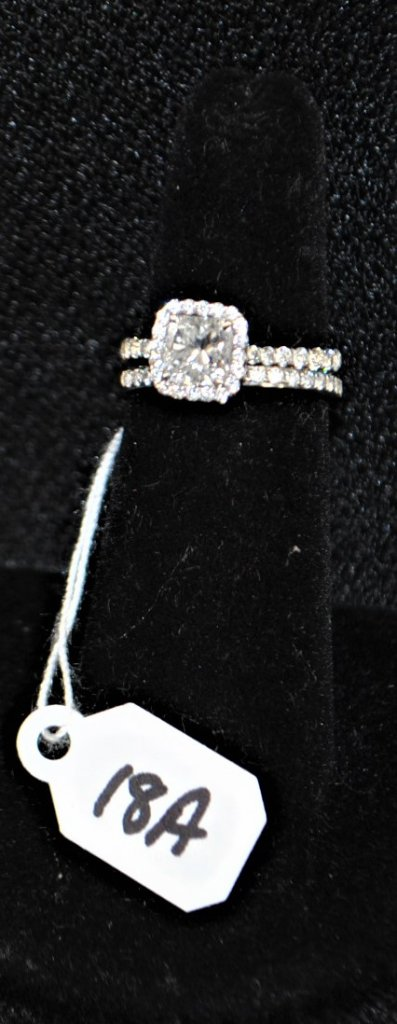 LADIES 18K WHITE GOLD HALO ENGAGEMENT RING. THE CENTER DIAMOND IS A 1.00CT CUT-CORNERED SQUARE MODIFIED BRILLIAN F COLOR AND VS1 CLARITY. THE DIAMOND MEASURES 5.56X5.5.5-X3.96MM SUPPORTED BY THE GIA 2111226795 DATED OCTOBER 14, 2009. THE DIAMOND IS SURROUND BY 36 PAVE SET ROUND BRILLIANT FG COLOR AND VS CLARITY WEIGHING .45CTTW. APPRAISED VALUE: $10,380.00. AND COMES WITH THE APPRAISAL FOR INSURANCE PURPOSES.