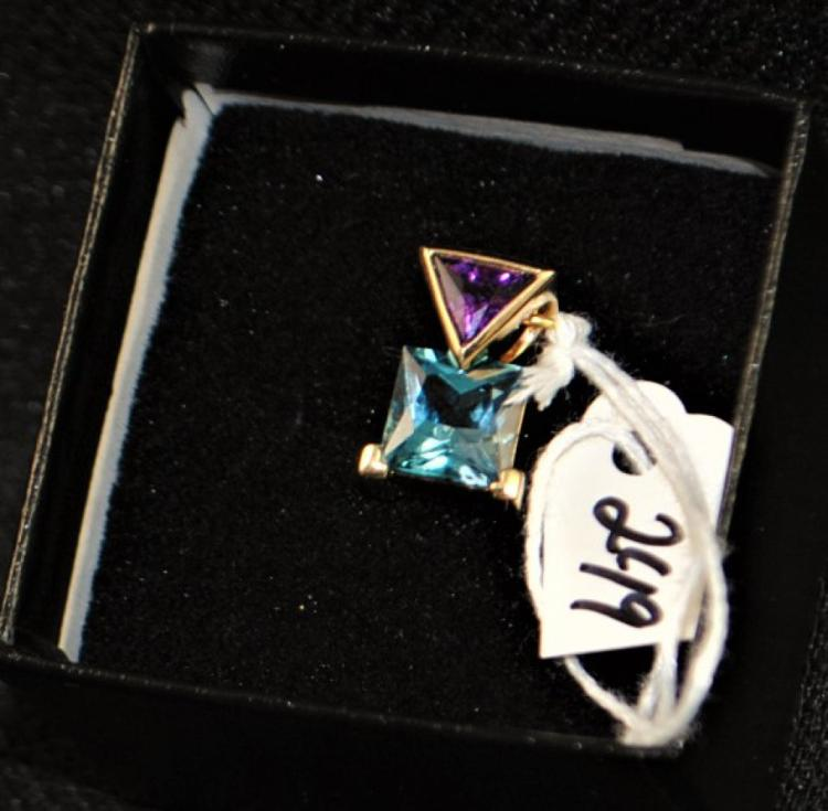 LADY'S 14K YELLOW GOLD CONTEMPORARY DESIGN PENDANT CONSISTING OF ONE GENUINE SQUARE CUT BLUE TOPAZ MEASURING 8.0MM, SET WITH A TRIANGULAR CUT GENUINE AMETHYST 7X7X7MM, BEZEL SET INTO THE BAIL. WEIGHS 2.5 DWT. REPLACEMENT VALUE: $850.00. AND COMES WITH THE APPRAISAL FOR INSURANCE PURPOSES.