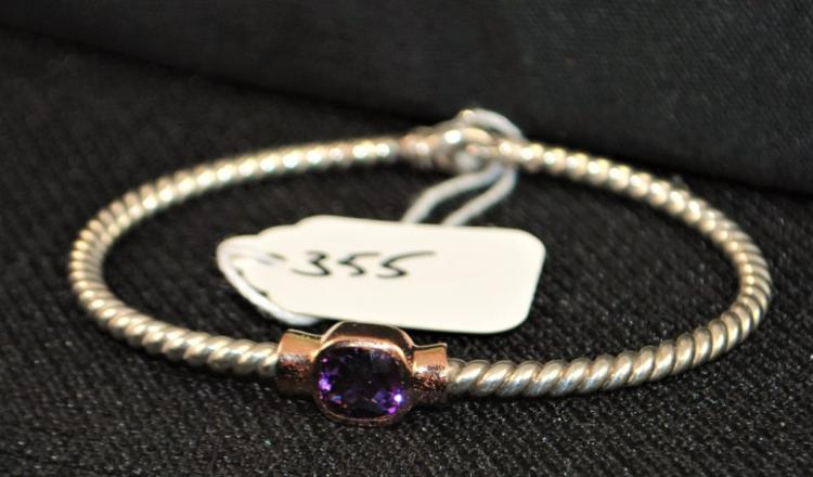 LADIES STERLING SILVER AND 14K PINK GOLD BANGLE BRACELET WITH ONE CENTERED, BEZEL SET, 7MM CUSHION CUT AMETHYST OF DEEP PURPLE COLOR. THERE IS A LOBSTER CLAW CLASP. THE BRACELET WEIGHS 9.3 DWT. REPLACEMENT VALUE; $495.00. AND COMES WITH THE APPRAISAL FOR INSURANCE PURPOSES.