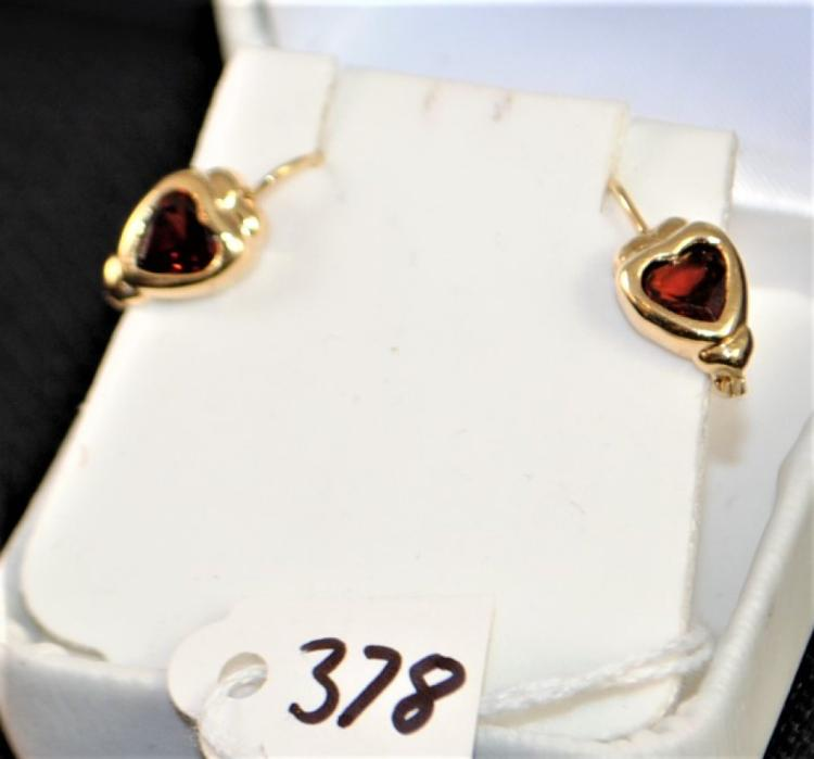 LADY'S 14K YELLOW GOLD HEART SHAPED GARNET EARRINGS WITH TWO GENUINE GARNETS MEASURING APPROX. 6MM EACH BEZEL SET INTO 14K YELLOW GOLD LEVER BACKS. WEIGHT: 1.6 DWT. REPLACEMENT VALUE: $350.00