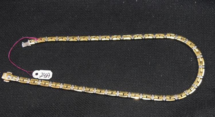 18K 750 (STAMPED) YELLOW AND WHITE GOLD FASHION NECKLACE. THE NECKLACE IS 6.5MM IN WIDTH, IS EQUIPPED WITH A TONGUE STYLE CLASP AND IS 17 INCHES IN LENGTH. THE TOTAL METAL WEIGHT: 30.61 GRAMS. THE TOTAL RETAIL REPLACEMENT VALUE: $5,325.00. AND COMES WITH THE APPRAISAL FOR INSURANCE PURPOSES.