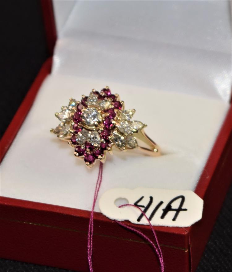 LADIES 14K (STAMPED) YELLOW AND WHITE GOLD DIAMOND AND RUBY FASHION RING. THE RING IS PRONG SET WITH (1) 3.6MM ROUND FULL CUT DIAMOND AND (14) 4.25-2.25MM MARQUISE SHAPE DIAMONDS FOR A TOTAL CARAT WEIGHT OF 1.75CTTW. ALL DIAMONDS HAVE A MINIMUM COLOR GRADE OF I AND CLARITY GRADE OF I1. THE RING IS ALSO PRONG SET WITH (18) 2.2-2.3MM ROUND SHAPE RUBIES FOR A TOTAL CARAT WEIGHT OF .75CTTW. ALL RUBIES ARE SINGLE A QUALITY. ALL GEMSTONES WERE GRADED WHILE SET IN THE MOUNTING AND CARAT WEIGHTS WERE CALCULATED BY FORMULA. TOTAL METAL WEIGHT WITH GEMSTONES: 6.43 GRAMS. TOTAL RETAIL REPLACEMENT VALUE: $4,750.00. AND COMES WITH THE APPRAISAL FOR INSURANCE PURPOSES..