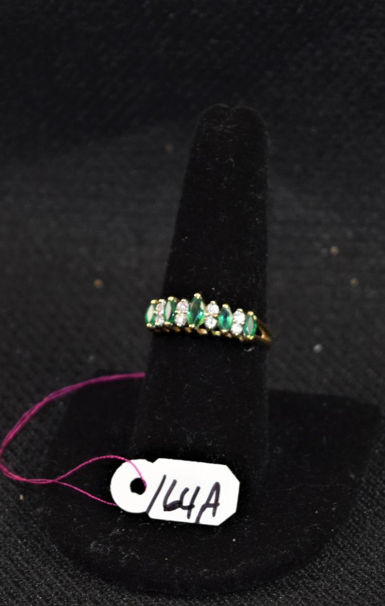LADIES 14K YELLOW GOLD DIAMOND AND EMERALD FASHION RING. THE RING IS PRONG SET WITH (8) 1.5-1.7MM ROUND FULL CUT DIAMONDS FOR A TOTAL CARAT WEIGHT OF .16CTTW. ALL DIAMONDS HAVE A MINIMUM COLOR GRADE OF I AND CLARITY GRADE OF I2. THE RING IS ALSO SET WITH (4) 3.5X1.75MM AND (1) 5.0X2.5MM MARQUIES SHAPE EMERALDS FOR A TOTAL CARAT WEIGHT OF .40CTTW. ALL EMERALDS HAVE A MINIMUM QUALITY GRADE OF SINGLE A. ALL GEMSTONES WERE GRADE WHILES SET IN THE MOUNTING AND CARAT WEIGHTS WERE CALCULATED BY FORMULA. TOTAL METAL WEIGHT WITH GEMSTONES: 3.12 GRAMS. TOTAL RETAIL REPLACEMENT VALUE: 1,000.00. AND COMES WITH THE APRAISAL FOR INSURANCE PURPOSES.