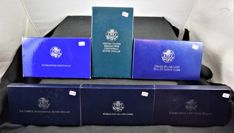 SIX $1 SILVER COMMEMORATIVE COINS WITH ORIGINAL BOXES AND CERTIFICATES OF AUTHENTICITYY - U.S. MINT BILL OF RIGHTS, U.S USO SILVER DOLLAR, U.S EISENHOWER CENTENNIAL SILVER DOLLAR, UNITED STATES LIBERTY COINS, U.S. CAPITOL BICENTENNIAL SILVER DOLLAR, WOLRD CUP USA 1994 COINS
