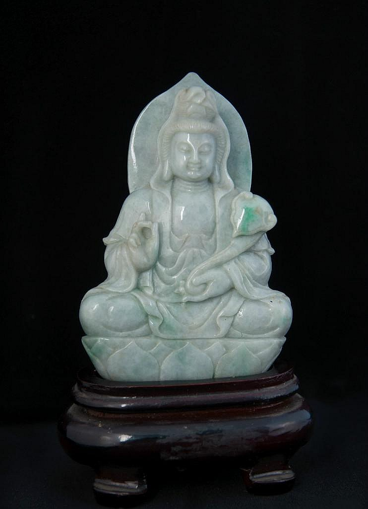 A CARVED JADE FIGURE OF GUANYIN