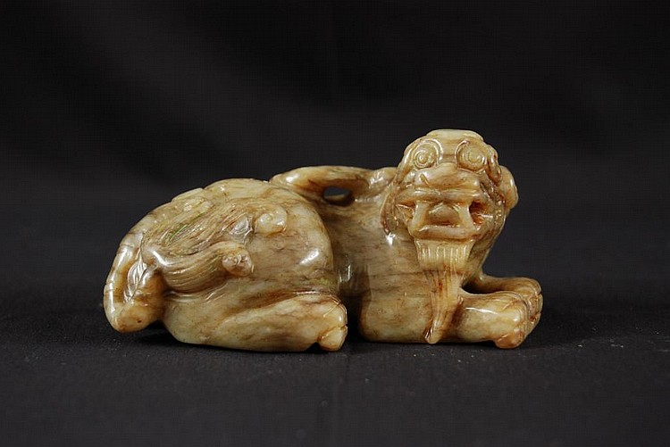 A GREEN JADE CARVING OF A LION DOG