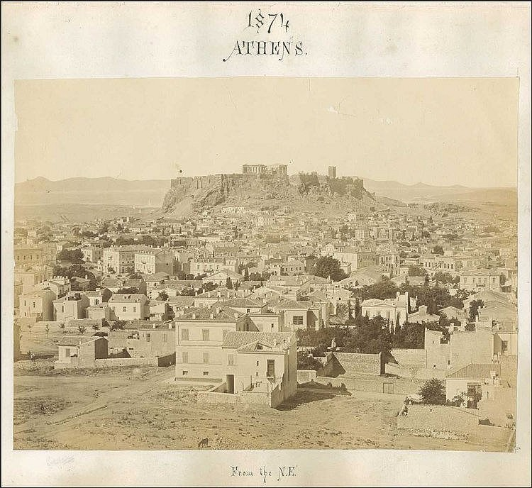 ATHENS 1874 from the N.E., scarce albument photo, panorama of Athens urban space with Acropolis on the background. Photo dim. 34x25cm, attached on thick carton dim. 45x36cm. Few chipped spots.