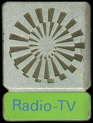 Munich 1972. Radio-TV Badge. Silvered bronze, 25.8x35mm. Lavender