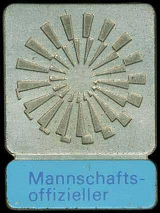 Munich 1972. Team Leaders Badge. Silvered bronze, 25.8x35mm. Lavender insc. on lt. blue bar. VF plus.