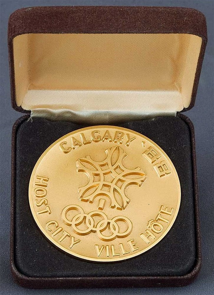 Calgary XV Olympic Winter Games 1988. Commemorative gold plated medal in original case. Legend