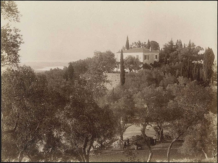ΚΕΡΚΥΡΑ - CORFU. Scarce albumen photo dim.27x20.5cm. Unknown photographer. Men repairing stone wall of large house. Cachet