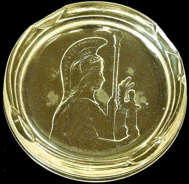 Ashtray with relief design of Minerva goddess holdind spear and Winged Victory figure (Nike) c.1930. Τασάκι με ανάγλυφη παράσταση που απεικονίζει τη θεά Αθηνά να κρατάει στο ένα χέρι δόρυ και στο άλλο φτερωτή Νίκη π.1930. Diam. 9.5cm. Excelent condit