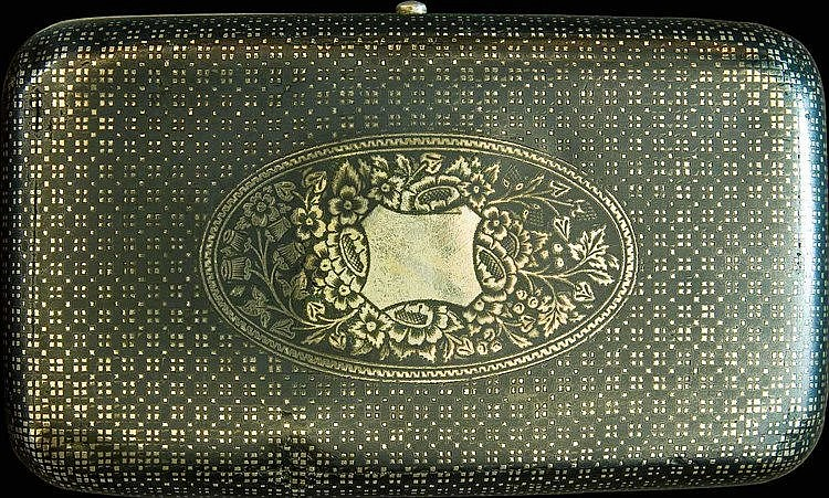 Turkish Silver and Niello Cigarette Case. Silver case with an excellent niello design of Ottoman Turkish war emblems on face sorounded by floral motifs on face. Weight: 118 grams. Length: 10 cm, width: 5.8 cm. Marked inside with hallmarks in Ottoman