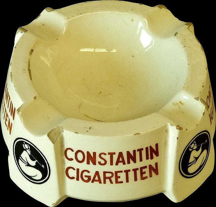 CONSTANTIN CIGARETTEN ceramic ashtray c.1920. Light crack. Diam.12cm, height 6cm.