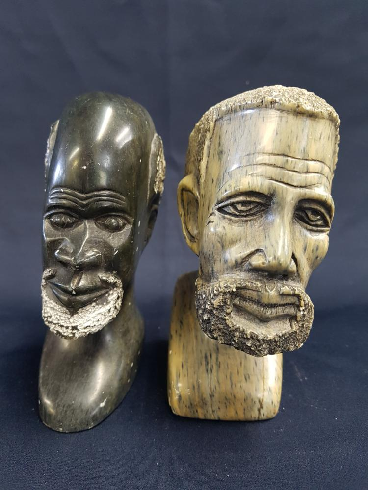 Two carved stone african busts