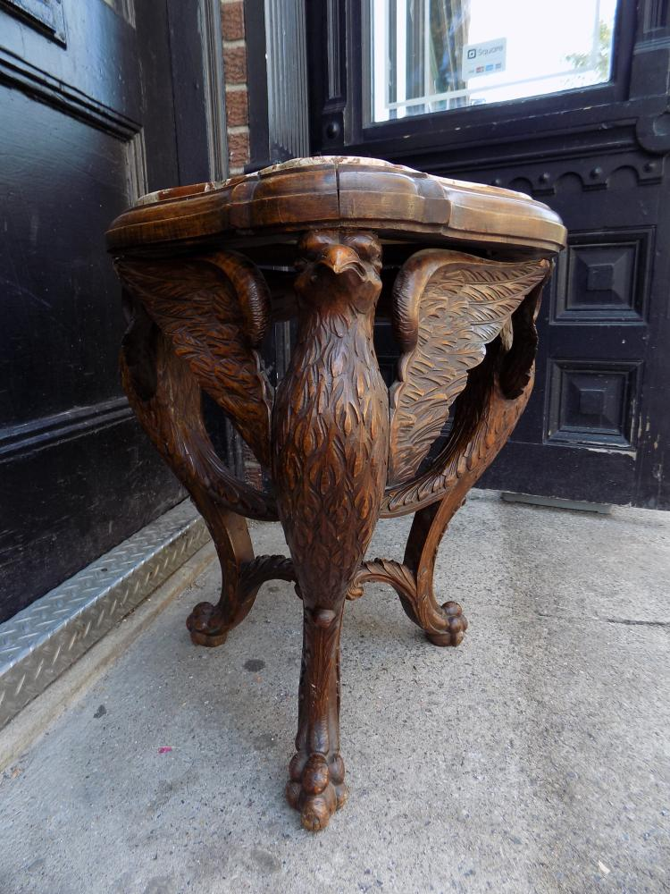 Marble top carved wooden eagle side table