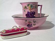 An old wash jug and basin decorated with grapes